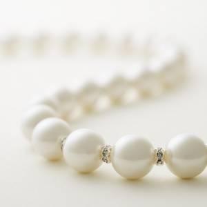 戴珍珠項鍊的女兒|魅麗雜誌
